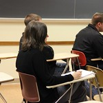 Students sitting in class during presentations.