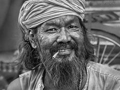 Street Portrait - Just because you are happy it does not mean that the day is perfect but that you have looked beyond its imperfections. (Louay Henry) Tags: nikon nikond610 d610 blackandwhite monochrome blackwhite india man beard mustache eyes closeup strangers character urban candid streetcandid streetlife streetphotography portrait streetportrait portraiture streetportraiture face human people homeless lonely poor happy tamron tamron2470mm life