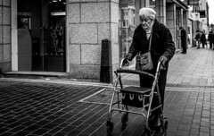 2017_21 (Chilanga Cement) Tags: fuji fujix100t x100t xseries x100s x100 monochrome bw blackandwhite woman lady trolley trolleys pavement sidewalk roadside road southport street streetphotography candid lightroom daylight detail