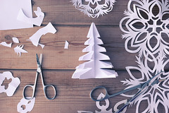paper snowflakes (lijphoto) Tags: tree decoration table aged white view new peace holiday cone old handmade christmas traditional snowflake wood decorate decorative age winter above paper origami wooden background grunge snow year rustic scissors