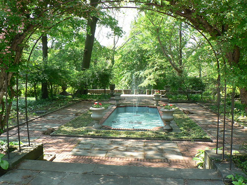 Garden with a fountain at the center.
