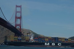 MSC Comin' Through (cwgoodroe) Tags: ocean sf sanfrancisco bridge sun fish eye beach june sailboat golden bay boat gate rocks surf ship pentax d vessel surfing fisheye goldengate surfboard area bayarea sail ist wetsuit pentaxistd june42006 sfchronicle96hours sfchronicle96hrs