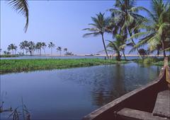 where the backwaters meet the sea (Ron Layters) Tags: sea india beach geotagged slide kerala transparency backwater pentaxmz10 godsowncountry thiruvananthapuram flickrfly kuttanad ronlayters geo:lat=842968 geo:lon=7695575 slidefilmthenscanned