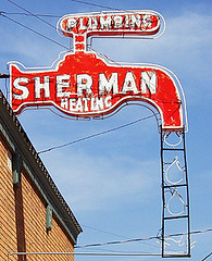 Sherman (FotoEdge) Tags: old 1920s light red summer signs hot brick electric photoshop advertising buzz lights store 1930s interesting rust downtown neon glow bright hometown steel letters plumbing sunny historic 1940s missouri 1950s storefront roadside heating quirky midwesttowns