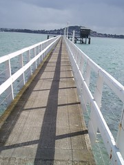 Pier (kate & dayle) Tags: shadow sky cloud white building green water concrete grey harbour rail wharf