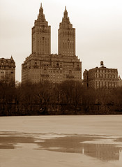 Central Park (Sepia) (Doubletee) Tags: park nyc newyorkcity winter lake snow newyork cold ice skyline sepia architecture geotagged frozen centralpark manhattan branches blizzard citypark cpw thelake centralparkwest apartmentbuildings urbanpark thedakota thesanremo