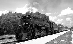 Milwaukee Road 261 (westbound) (Jim Frazier) Tags: old railroad blackandwhite bw building history classic industry station june metal wisconsin train wow vanishingpoint shiny track commerce power angle v100 antique platform tracks engine machine engineering rail railway 2006 monotone heavymetal f10 historic equipment business machinery railwaystation trainstation rails depot historical americana locomotive f3 lacrosse heavy powerful f5 q3 apparatus excursion railroads 261 traindepot railroadstation v200 monochome passengertrain bwset amtrakstation v500 threequarter v1000 milwaukeeroad v2000 explored interestingness488 threequarterangle lacrosse261 lacrossetrains jimfraziercom wmembed