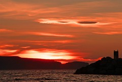 Sunset over Bell Island (Mark Veitch) Tags: ocean light sunset red sea sky water beautiful rock tag3 taggedout clouds newfoundland island tag2 waves tag1 breakwater conceptionbay bellisland portugalcove 123ac