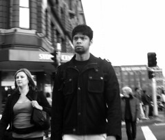 Mien (Lachlan Hardy) Tags: street woman man manipulated walking blurry crossing sydney streetphotography australia nsw surryhills levels greyscale thecommute pc2010 auspctagged 20060707