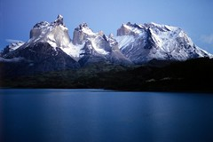 Mighty (Walter Quirtmair) Tags: 2005 chile november light patagonia lake snow mountains film southamerica water tripod torresdelpaine coolscan swq takenbywalter eos300 lagopehoe summits elevation25003000m mountainsandes summittorresdelpaine specland seriespehoemorning canon35105