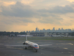 Storm Delays at LaGuardia (Jim Frazier) Tags: new york city newyorkcity travel sunset urban newyork industry metal airplane airport scenery waiting shiny commerce cityscape v100 dusk aircraft aviation jet july 2006 business airline wait americanairlines airliner q4 laguarida nyctjuly2006 jimfraziercom