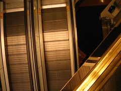 Toowong Village Escalators (mtyto) Tags: urban reflection bronze canon shoppingcentre brisbane shoppingmall brisvegas layers escalators levels toowong ixy canonixydigitall2 canonpowershotsd20 toowongvillage mtyto canondigitalixusi5