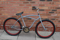 Naked (The Bicycle Basketeer) Tags: red bike coaster cruiser coasterbrake primergrey 26inch kendaflame dunlopseat