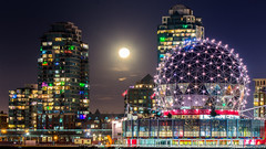 Christmas Moon (Sworldguy) Tags: moon falsecreek colourful condos creekside urban vancouver scienceworld dazzling nightscene zoom lights longexposure halo geodesic architecture skyline cityscape nikon d7000 dslr downtown
