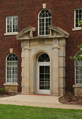 Doorway, Mauck Dorm, Hillsdale College  Hillsdale, Michigan (Pythaglio) Tags: county windows building brick college broken stone michigan dorm entrance frieze structure historic sidewalk doorway classical dormitory pediment carvings entry hillsdale ionic transom capitals 1927 patera entablature keystones pilasters casement sills volutes paired dentils mauck roundarched