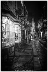 Day 8 (lizzieisdizzy) Tags: howiemarsh monomonochrome bkackandwhite night nighttime dark darkness alley alleyway window windows bright light glowing people cobbles slabs oldfashioned quaint york minster