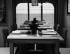 dinner at sea (-gregg-) Tags: bw sea ocean dinner table window reflection cruiseship