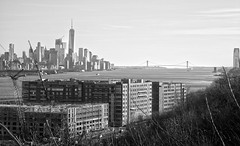 Urban Riverview (michaelelliottnyc) Tags: nj newjersey ny newyork newyorkcity manhattan lowermanhattan wtc worldtradecenter buildings warehouses skyscrapers urban city metropolis river water hudsonriver bridge boats trees bw blackandwhite monochrome cranes construction downtown