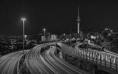 Every Direction (Jarrad.) Tags: architectural auckland bw blackwhite bridge cityscape d800e jaymarksimages lighttrails mono monochrome newzealand nikon notthefirst skytower motorway spaghetti junction