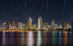 San Diego Skyline (maxgilberg) Tags: astrophotography night city stars lights water reflection sandiego startrail startrails sandiegoskyline