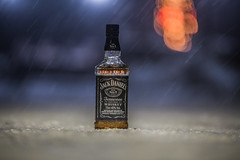 For the cold winter nights... (Vagelis Pikoulas) Tags: drink jack daniels bottle bokeh snow night lights canon 6d tamron 70200mm vc winter january 2017