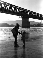 Encounters on ice (skamalas) Tags: mother child kid ice skating