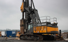 Drilling. (HivizPhotography) Tags: orange rain river construction aberdeenshire outdoor rig vehicle abi machines dee drill delmag drilling tracked milltimber awpr rh28