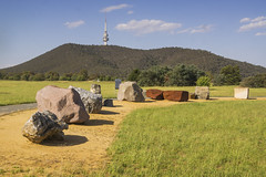 National Rock Garden (Kokkai Ng) Tags: park travel blue sky mountain tower tourism nature grass rock horizontal stone day large australia nopeople boulder collection canberra geology showing bizarre inarow blackmountaintower formalgarden australiancapitalterritory capitalcities famousplace physicalgeography