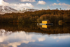 Lochside Cabin (Brian Travelling) Tags: lochgarry highlands highland scotland scenery lochsidecabin cabin lochside trees tranquil tranquility pentaxkr pentax pentaxdal peaceful peace water reflection clouds sky