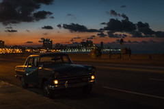the Malecón at sunset (Tripping Along) Tags: natgeoexpeditions cuba havana malecón classiccar