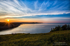 Closing out the Day  (or year in this case) (Dwood Photography) Tags: closing out day or year this case closingoutthedayoryearinthiscase newfoundland 2016 dwoodphotography dwoodphotographycom sunset water ocean atlantic atlanticocean blue yellow sunburst grass