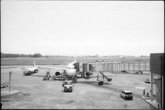 Ritorni (|γ|S| GammaSintesi) Tags: minox35gt blackandwhite bw ilford hp5plus film catania aeroporto airport italia italy monocrome pellicola v700 arsimago monobath
