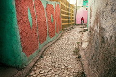 Streets of Harar (departing(YYZ)) Tags: harar ethiopia africa street cobblestone woman travel people hijab daytime outside