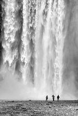 Nature's might (halifaxlight) Tags: bw mist waterfall iceland silhouettes riverbed southcoast figures cataract skogafoss