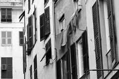 Windows. Genoa. (sldrukman76) Tags: travel windows italy building architecture blackwhite mediterranean medieval genoa shutters clotheslines