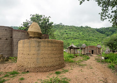 Togo, West Africa, Nadoba, traditional tata somba houses with thatched roofs and granaries (Eric Lafforgue) Tags: poverty africa houses color castle horizontal architecture rural outdoors village african traditional tata culture nobody nopeople tribal unesco worldheritagesite roofs warehouse westafrica greenery togo benin copyspace tradition tribe urbanism voodoo granary thatched developing vodun vodoun voudou granaries fortifiedhouse somba colourimage tamberma taberma atacora tammari vodon batammariba  nadoba    benin02593
