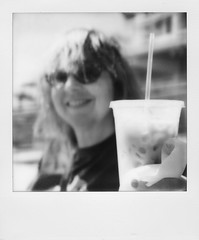 Laura and Iced Coffee (thereisnocat) Tags: beach sx70 newjersey asburypark nj boardwalk monmouthcounty impossibleproject gen20bw gen20bwsx70
