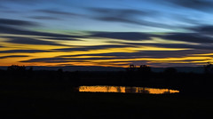 Ducks and Cover (Wilkof Photography) Tags: longexposure autumn trees light sunset shadow sky lake motion mountains west reflection nature water field skyline barn rural canon fence landscape golden evening countryside geese pond haze md colorful skies view nightshot natural cloudy dusk gorgeous south horizon hill flight perspective scenic meadow vivid ducks surreal maryland peaceful overcast eerie panoramic farmland nighttime le nd land backcountry serene roadside hillside treeline backroads gusty picturesque tranquil vantage frederick visibility ndfilter neutraldensity t4i canont4i catooctin wilkof