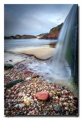 Falling Water (jeremy willcocks) Tags: hopecove devon southhams england uk colour water sea beach pebbles sand houses cliffs jeremywillcocks wwwsouthwestscenesmeuk fujixt10 xf1024 landsape seascape