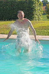 Plop! (Lark Ascending) Tags: plop splash jump dive pool swimming france dordogne trunks spray water