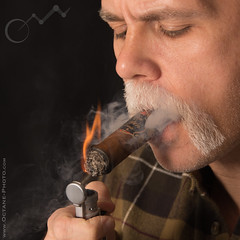 Goatee and Flame... (octane-photo) Tags: cigars cigar cigarmen facialhair goatee goatees flannel officerstephens mustache mustaches mensmokingcigars mensmoking menwhosmokecigars smokingmen menwhosmoke