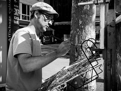 Painting the tree (SibretManu) Tags: streetphotography luxembourg portrait street black white bw noir et blanc monochrome candid going moments decisive moment creative commons flickr flickriver explore eyed eye scene strassenfotografie fotografie city square squareformat photography bwartaward