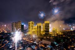 Firework on New Year`s Eve in Manila, Philippines. (2017 January 1.) (rolandnagy) Tags: architecture celebration firework philippines manila makati illuminated outdoors 2017 asia downtown condominium twilight midnight 2017january1 fireworks newyearseve rockwell skyline nikon nikond810
