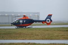 G-GLAB parked. (aitch tee) Tags: cardiffairport aircraft helicopter eurocopter ec135t2 parked gglab cwlegff maesawyrcaerdydd walesuk