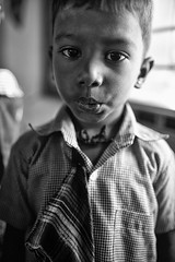 The Comedian (alisdair jones) Tags: ef35mmf14lusm portrait child boy preschool uniform nainativu sri lanka