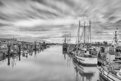 Boats, Sea and Sky (jbarc in BC) Tags: ocean longexposure sea sky cloud glass vancouver docks boats outdoors dock marine bc time smooth richmond westcoast steveston blackdiamond bestcapturesaoi elitegalleryaoi