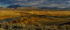 Kremmling along the Colorado. (bunyan bug) Tags: autumn fall clouds train river gold golden fan oak colorado butte rail route zephyr aspens scrub railfan cottonwoods amtrack kremmling