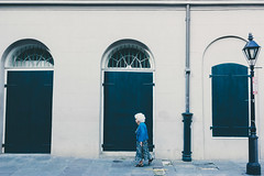 Alone (moony: stupidly dreamy) Tags: street old windows woman white lines candid neworleans frenchquarter whitehead nola nawlins luisiana