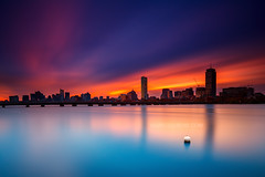 Back Bay Boston Skyline with Prudential and Hancock Towers over Harvard Bridge and Charles River with Buoy at Sunrise from Cambridge MA USA (Greg DuBois - Sponsored by LEE Filters) Tags: city longexposure morning bridge pink blue sky urban usa motion water skyline architecture clouds sunrise canon buildings river photography morninglight early downtown cityscape waterfront skyscrapers unitedstates cloudy charlesriver newengland surreal wideangle calm waterblur backbay waterway hancocktower cityskyline waterreflection bostonskyline waterscape prudentialtower urbanriver bostoncityscape mirrorreflection downtownboston ndfilters charlesriveresplanade cloudmovement charlesriverreservation smoothwater cambridgemassachusetts neutraldensity reflectivewater bostonphotographer leefilters bostonsunrise backbayboston colorfulsunrise bostonphotography canon6d bigstopper gregdubois gregduboisphotography bostonphotoprints mitpierceboathouse memorialdriveharvardbridge bostonstockphotography bostonstockphotos