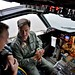 Adm. Mark Ferguson is briefed on the capabilities of the P-3C Orion.